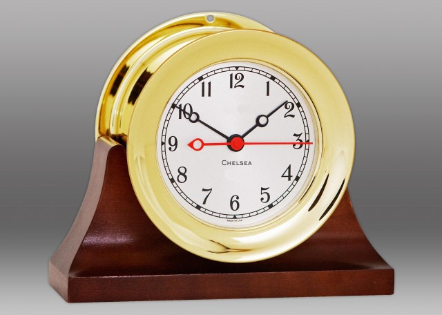 "4 1/2"" Shipstrike Quartz Clock in Brass on Contemporary Base"